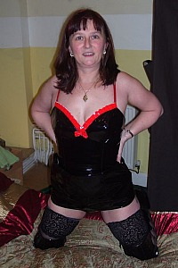 Slut wife Dec in Pvc dress and boots with black stockings
