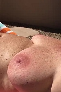 Mature wife tanning naked