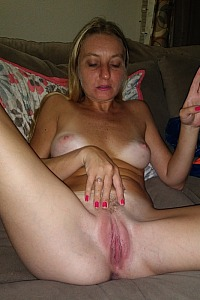 Girlfriend spreading her legs showing pussy
