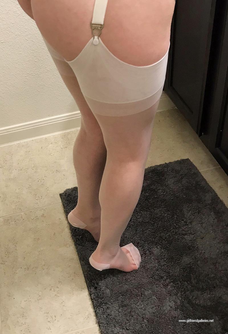 Nicole posing in white