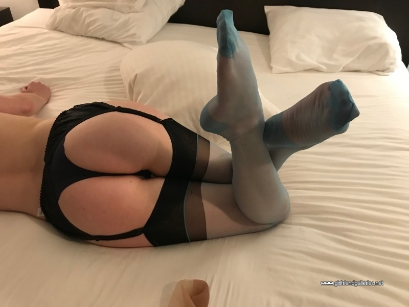 Beautiful Nicole posing in turquoise and black one